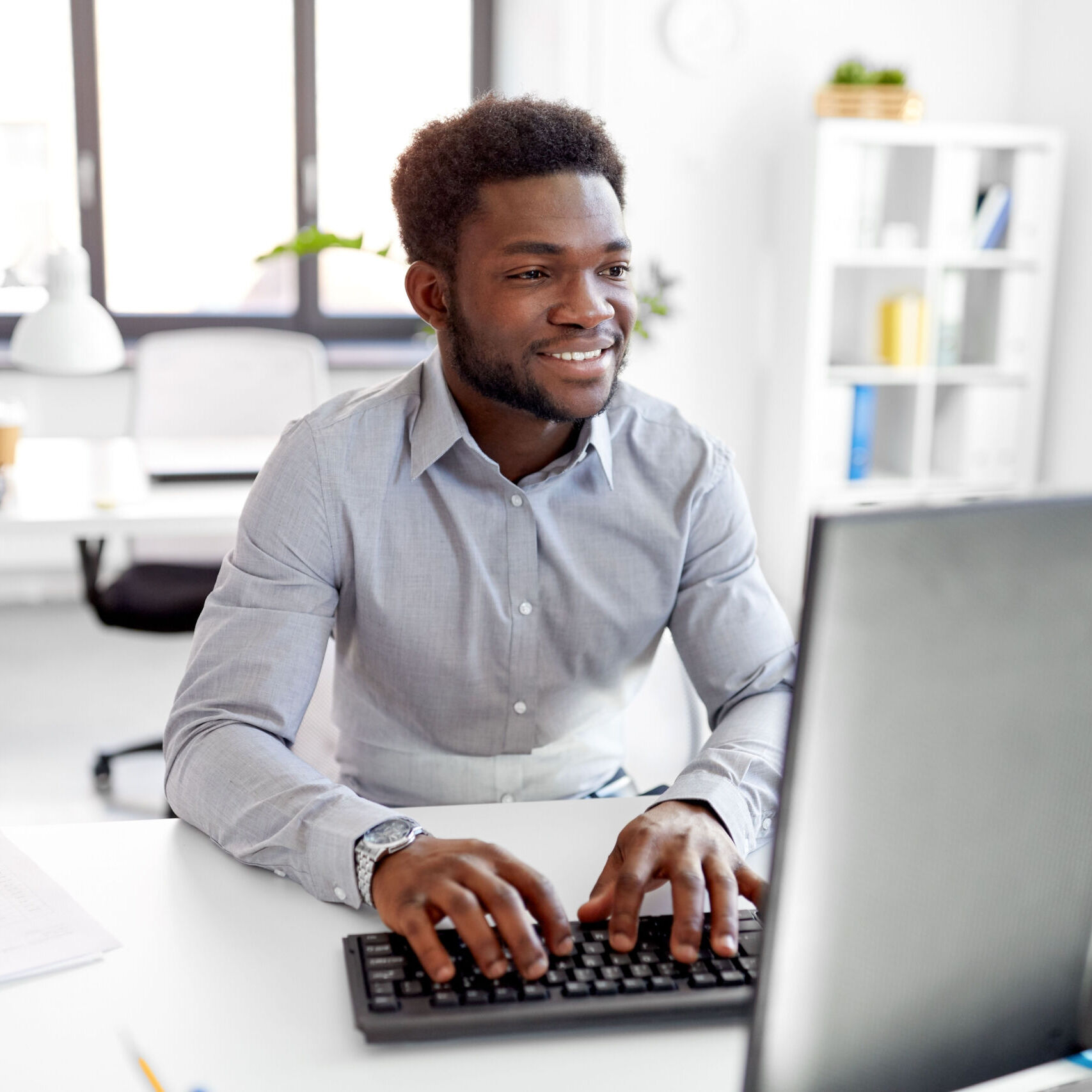 african businessman works with computer at office